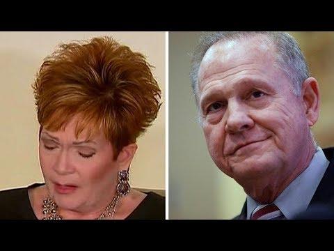 Roy Moore attorney questions accuser's story, demands her yearbook