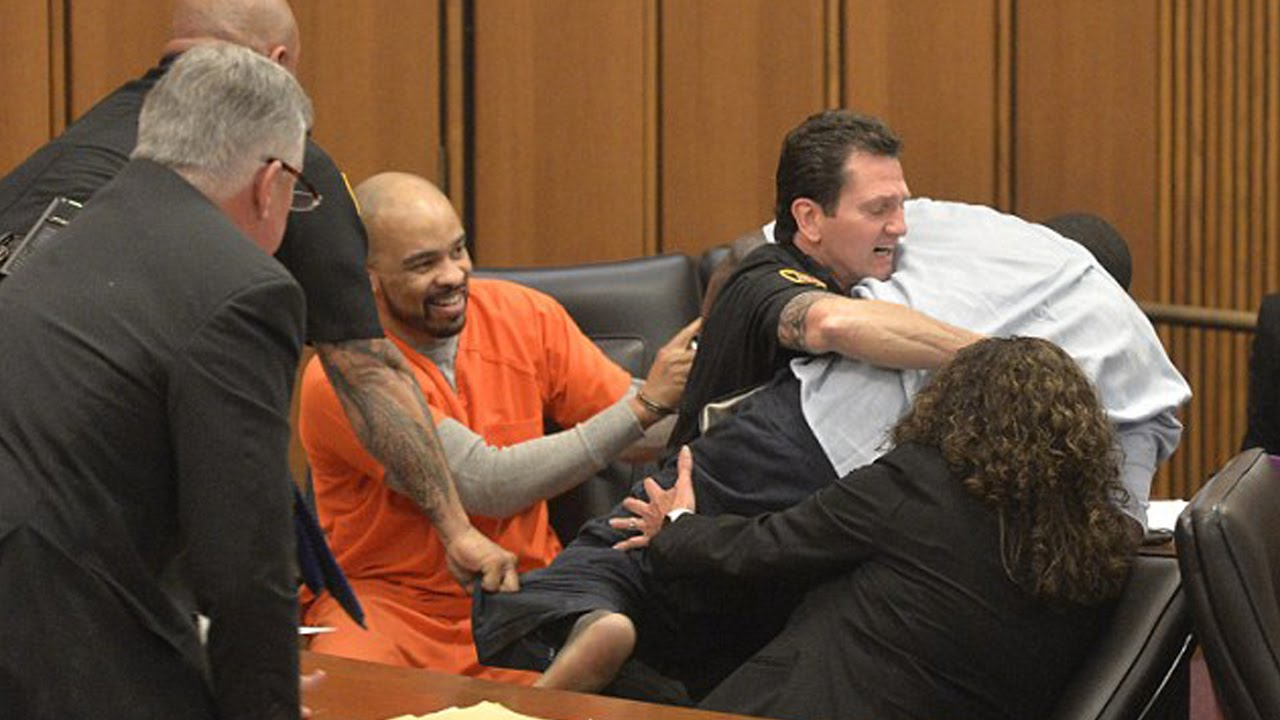 Father leaps at daughter's killer in court