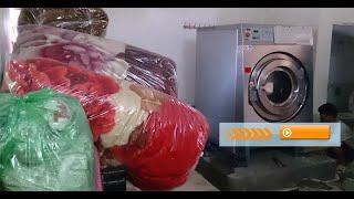 Máy giặt công nghiệp image thái lan giặt chăn cho dân sinh.