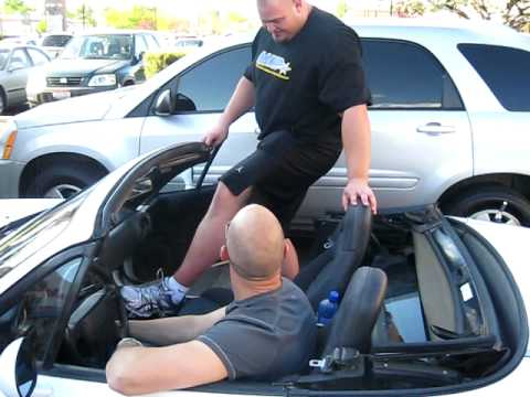 Brian Shaw getting into a Mazda Miata.