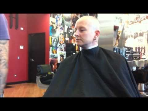 Women S Head Shave In A Barbershop With A Straight Razor