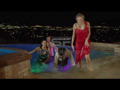Medium slow motion shot of well-dressed people exiting pool
