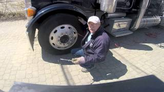 Checking Tire Pressure and Inflating Tires on a Big Rig