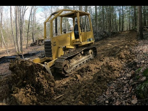 Pushing in a driveway with a bulldozer