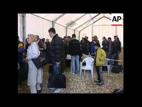 KOSOVO: PRISTINA AIRPORT: ALBANIAN REFUGEES RETURN