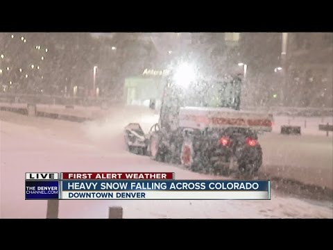 Dangerous road conditions: Snow-packed roads and blowing snow in Denver