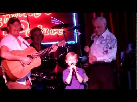 7 year old boy singing on stage with George Jones - Louisiana Saturday Night and White Lightning