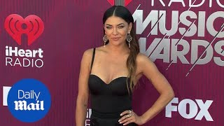 Racy in lace! Jessica Szohr arrives at iHeartRadio Awards