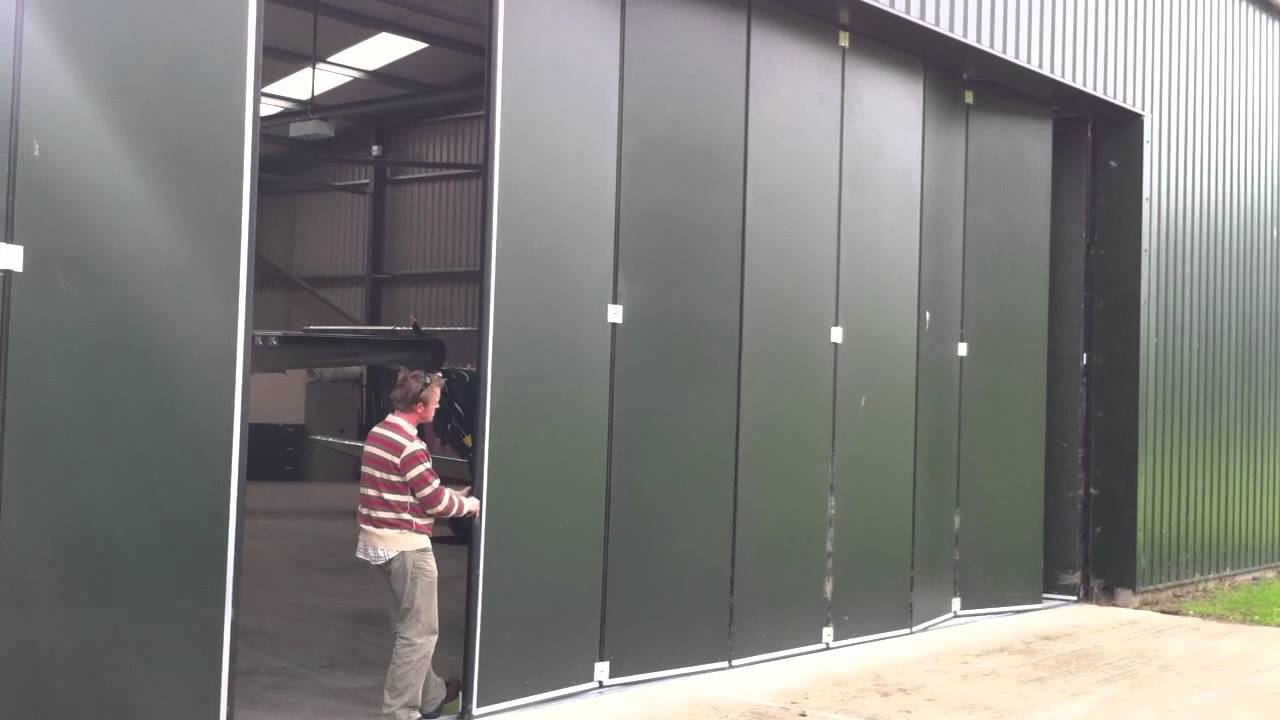 Osprey manually operated sliding folding doors & Osprey manually operated sliding folding doors - YouTube