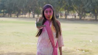 Young girl showing a stop abusing sign during Holi celebration - women abuse concept