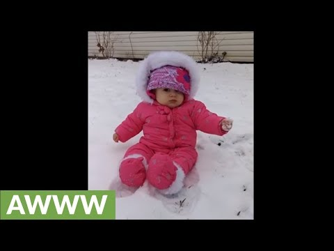 - Baby Experiences Snow For The First Time...