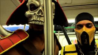 Scorpion and Shao Kahn ride the subway to Earth Realm