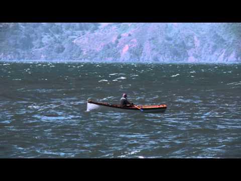 Man on Rowboat in European Seas