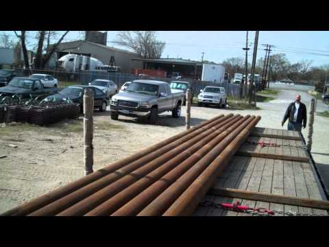 Load of Pipe Unloaded by a GENUS