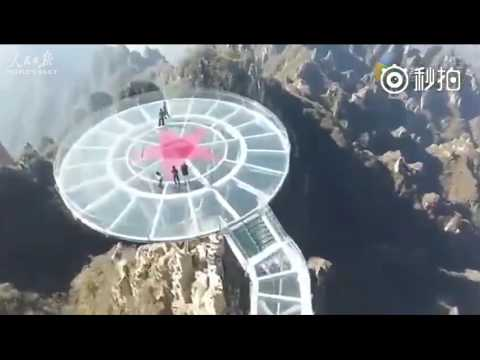 Thrill seekers rejoice: aerial view of a sky-high glass bridge atop the Mount Langya in N. China