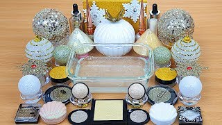 white-gold-slime-mixing-makeup-and-glitter-into-clear-slime