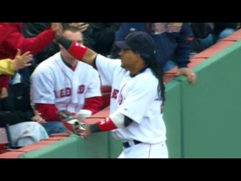 Ramirez makes the catch and high-fives a fan