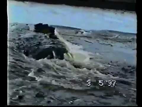Russian Truck Gets Pulled Out of Raging River by the Ocean