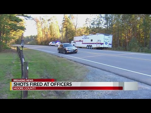 Moore County officials searching for 2 men who shot at officers