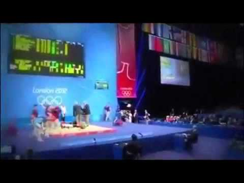 London Olympics - German weightlifter drops 432-pound barbell on his head
