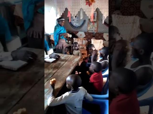 Children Eating Bread with bro Haron @ WFF Moi's Bridge Kenya 2 25 2018