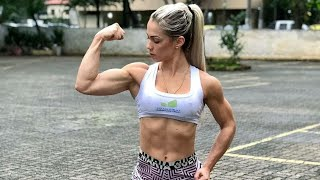 Young muscle girl flexing