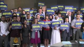 Journalists hold vigil for jailed Al Jazeera staff