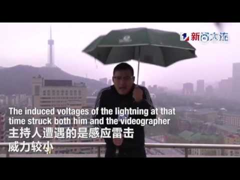 Chinese weather man hit by lightning bolt while holding an umbrella doing LIVE broadcast in a storm : hit by lightning - azcodes.com
