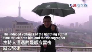 Chinese weather man hit by lightning bolt while holding an umbrella doing LIVE broadcast in a storm
