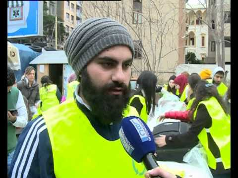 Local news coverage from Beirut - True Change volunteering at clothing drive for Syrian Refugees.