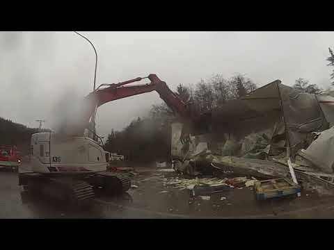 SEMI JUMPS STATE HIGHWAY LOSES LOAD