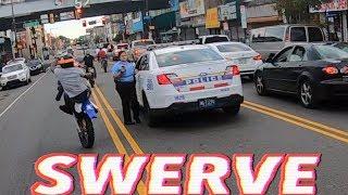 DIRT BIKE SWERVES A COP CAR !