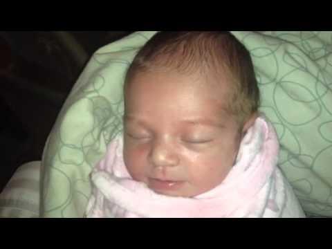 One Week Old Baby Laughing In Sleep.
