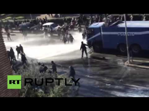 Italy: Water cannon unleashed as police clash with squatters at Rome eviction
