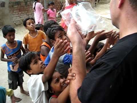 Life In A Day - Handing out treats to slum kids - India