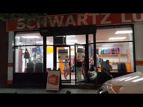 Happy customers leaving luggage-free Schwartz luggage storage / Penn Station Midtown Manhattan