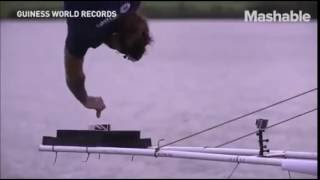 NEW GUINNESS WORLD RECORD- Man dips biscuit in tea from 230 feet (70.1m)