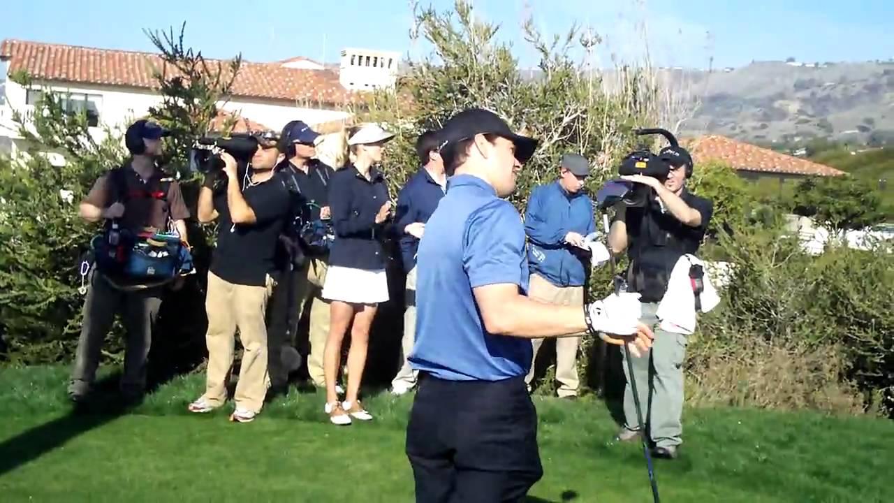 Mark Wahlberg driving a golf ball at Trump National Golf ...