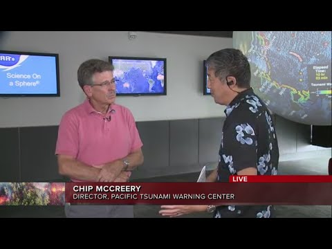 Manolo Morales with Chip McCreery at the Pacific Tsunami Warning Center