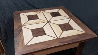 Coffee table out of maple and walnut with a geometric design