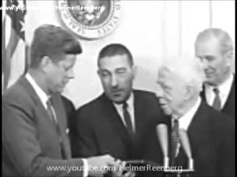 March 26, 1962 - President John F. Kennedy receives a book of new poems by author Robert Frost