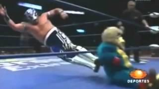 Mexican Wrestler Dropkicks Midget in a Monkey suit