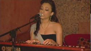 "Karina Pasian performing "" First Love "" in NYC."
