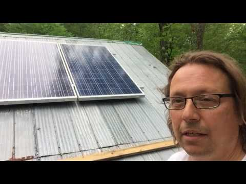 Solar panel roof install in off grid cabin