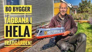 Bo bygger tågbana i hela trädgården