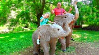 Milana and papa plays at the zoo park