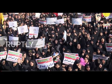 Iran: Government supporters rally in Tehran following unrest