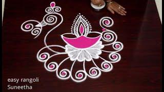 #Karthika Masam Special kolam rangoli designs with Diyas    Creative Peacock rangoli muggulu