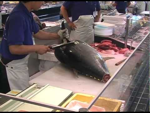 Maguro (bluefin tuna) being carved for sale in Osaka, Japan