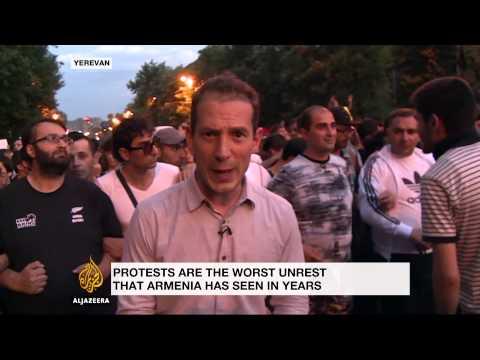 Protestors shut down streets in Armenia's capital for third night